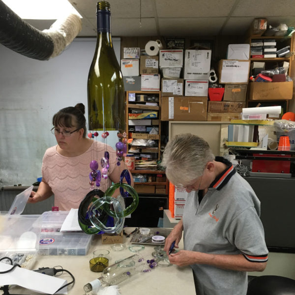 Wine bottle wind chime class students designing and laying out project