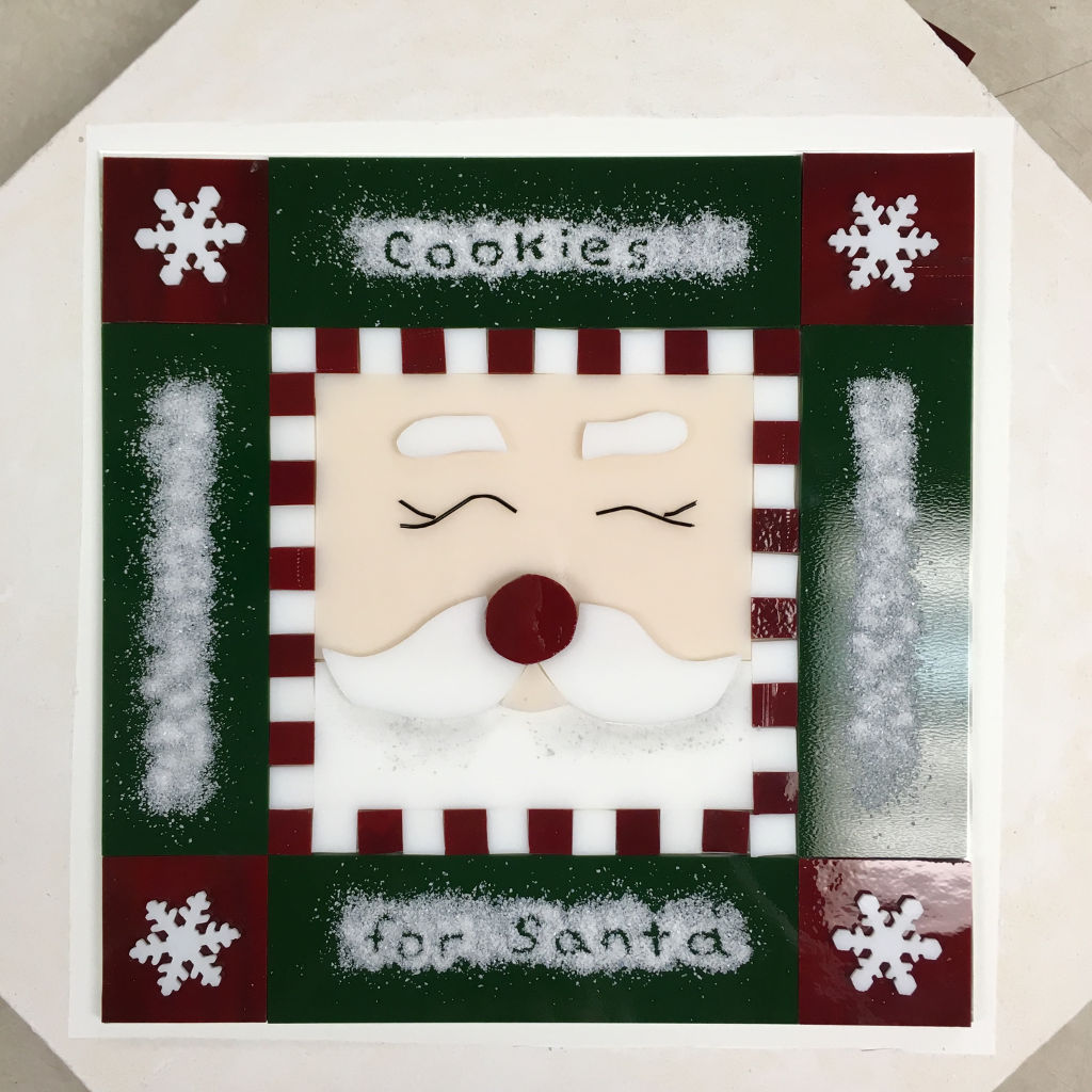 Fused santa cookie tray with snow frit before kiln firing
